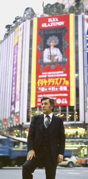 Ilya Glazunov in front of Poster of His Personal Exhibition in Japan. Tokyo